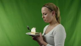 Girl eating pie stock footage