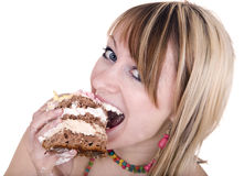 Girl eating piece of cake. Stock Photo