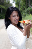 Girl eating pizza Stock Photos