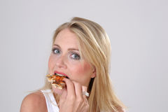 Girl eating Pizza Stock Images