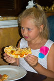 Girl eating pizza Stock Photo