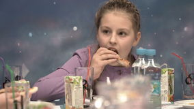 Girl eating pizza stock video footage