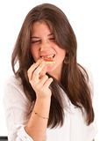 Girl eating pizza with relish. Image of a young girl eating a piece of pizza with relish Stock Photography