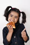 Girl eating pizza slice royalty free stock images