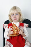 Girl eating pizza slice Royalty Free Stock Photography