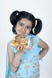 Girl eating pizza slice Royalty Free Stock Photos