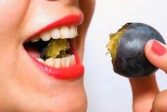 Girl eating a plum closeup 9 Royalty Free Stock Photos