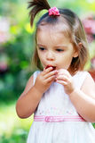 Girl eating plum Stock Photo