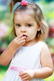Girl eating plum Royalty Free Stock Photos