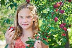 Girl eating a plum Stock Photo