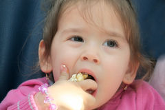 Girl eating pop corn Stock Photo