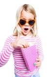 Girl eating pop corn Stock Photos
