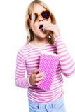 Girl eating pop corn Royalty Free Stock Image