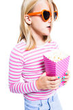 Girl eating pop corn Stock Images