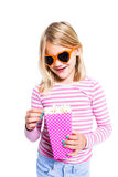 Girl eating pop corn and smiling Stock Photo