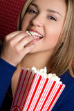 Girl Eating Popcorn Royalty Free Stock Images