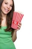 Girl Eating Popcorn. Smiling teenage girl eating popcorn Stock Photos