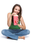 Girl Eating Popcorn. Pretty teen girl eating popcorn Stock Photography