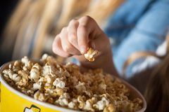 Girl Eating Popcorn In Cinema Theater Royalty Free Stock Images