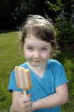 Girl eating popsicle Royalty Free Stock Image