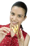 Girl eating potatoes Royalty Free Stock Images