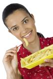 Girl eating potatoes Royalty Free Stock Image