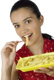 Girl eating potatoes Stock Images
