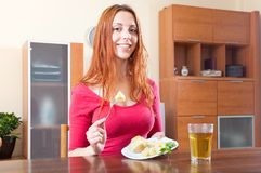 Girl eating potatoes at home Royalty Free Stock Photography