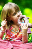 Girl eating pretzel. Little girl eating a chocolate pretzel stock images
