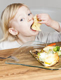 Girl eating quesadilla Royalty Free Stock Photos