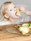 Girl eating quesadilla Royalty Free Stock Photos