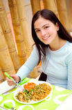 Girl eating in a restaurant Royalty Free Stock Photo