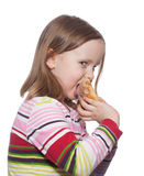 Girl eating roll isolated white Royalty Free Stock Images