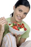 Girl eating salad Royalty Free Stock Image