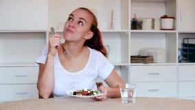 Girl eating salad stock video