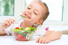 Girl eating salad Stock Images