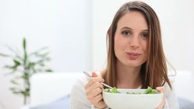 Girl eating salad stock footage