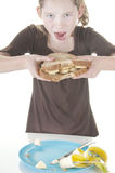 Girl eating sandwich Royalty Free Stock Photos