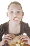Girl eating sandwich Royalty Free Stock Photo