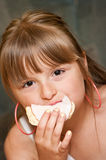 Girl eating sandwich Stock Images