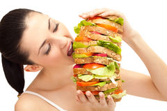 Girl eating sandwich, big bite Stock Image