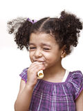 Girl Eating Sandwich - Bite. Girl Eating Sandwich with a Childish Bite Royalty Free Stock Image
