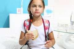 Girl eating a sandwich Stock Photos