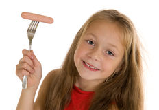 Girl eating sausage Royalty Free Stock Photos