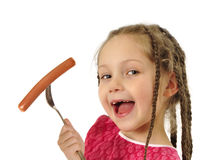 Girl eating sausage Royalty Free Stock Image