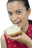 Girl eating slice of bread Royalty Free Stock Photography