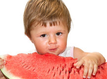 Girl eating a slice of watermelon Stock Images