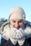 Girl eating snow Stock Photos