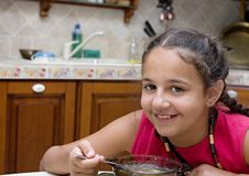 Girl eating soup Stock Photos