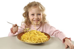 Girl eating spaghetti Stock Photography